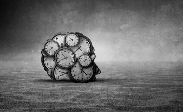 caracteristicas-de-la-ilustracion-cerebro-relojes-istock